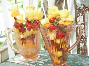 beautiful fruit kabobs served in pink depression glass